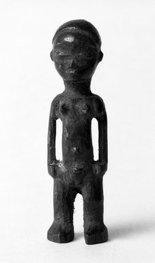 Pende (Western). <em>Miniature Figure of a Standing Female</em>, late 19th-early 20th century. Wood, 3 1/2 x 1 x 3/4 in. (8.7 x 2.5 x 2.0 cm). Brooklyn Museum, Gift of Jerome Furman, 70.106.4. Creative Commons-BY (Photo: Brooklyn Museum, 70.106.4_bw.jpg)