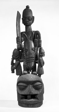 Yorùbá. <em>Epa Mask</em>, late 19th or early 20th century. Wood, 39 1/4 x 15 x 18 in.  (99.7 x 38.1 x 45.7 cm). Brooklyn Museum, Gift of David R. Markin, 70.107.13. Creative Commons-BY (Photo: Brooklyn Museum, 70.107.13_front_bw.jpg)
