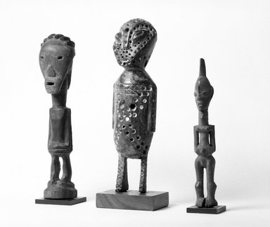 Lega. <em>Standing Figure with Punctuations</em>, late 19th or early 20th century. Wood, pigment, 9 1/4 x 2 1/2 x 2 1/2 in. (23.5 x 6.4 x 6.2 cm). Brooklyn Museum, Gift of David R. Markin, 70.107.17. Creative Commons-BY (Photo: , 70.107.14_70.107.17_70.108.1_bw.jpg)