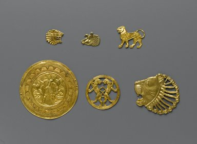 Achaemenid. <em>Dress Ornament</em>, 6th-5th century B.C.E. Gold, 1 13/16 × 2 5/16 in. (4.6 × 5.8 cm). Brooklyn Museum, Gift of Mr. and Mrs. Alastair Bradley Martin, 70.142.11. Creative Commons-BY (Photo: , 70.142.6-.11_PS2.jpg)