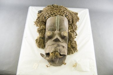 <em>Mask</em>, late 19th-early 20th century. Wood, ivory tusks, copper, fur, hide, cowrie shells, 14 1/2 in.  (36.8 cm). Brooklyn Museum, Gift of Jerome Furman, 70.151.5. Creative Commons-BY (Photo: Brooklyn Museum, 70.151.5_front_PS5.jpg)