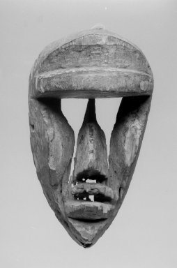 Possibly Dan. <em>Mask</em>, late 19th-early 20th century. Wood, 8 7/8 x 5 x 4 3/4 in. (22.5 x 12.7 x 12.1 cm). Brooklyn Museum, Gift of Dr. Robert Walzer, 70.156.4. Creative Commons-BY (Photo: Brooklyn Museum, 70.156.4_bw.jpg)