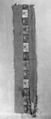 Coastal Wari (attrib by Nobuko Kajatani, 1993). <em>Mantle, Fragment or Mantle, Border, Fragment</em>, 600-1000 C.E. Cotton, camelid fiber, 5 1/2 x 26in. (14 x 66cm). Brooklyn Museum, Gift of Ernest Erickson, 70.177.13. Creative Commons-BY (Photo: Brooklyn Museum, 70.177.13_cropped_bw_IMLS.jpg)