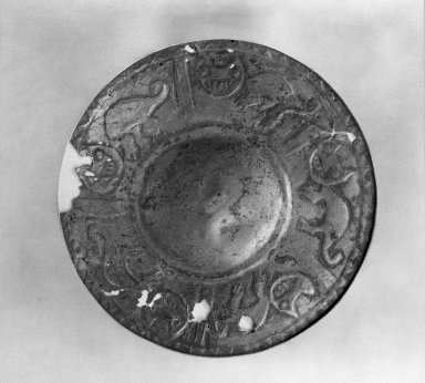 Chimú. <em>Circular Disk</em>. Metal (silver plated), Diam: 7 1/2 x 7 1/2 in. (19.1 x 19.1 cm). Brooklyn Museum, Gift of Ernest Erickson, 70.177.35. Creative Commons-BY (Photo: Brooklyn Museum, 70.177.35_acetate_bw.jpg)