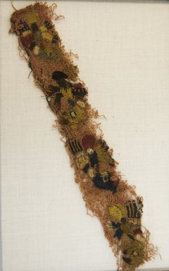 Proto-Nazca (curvilinear, attrib by Nobuko Kajatani, 1993). <em>Textile Fragment, unascertainable or Textile Fragment, Border, undetermined</em>, 200-600 C.E. Cotton, camelid fiber, 6 5/16 x 1in. (16 x 2.5cm). Brooklyn Museum, Gift of Ernest Erickson, 70.177.52. Creative Commons-BY (Photo: Brooklyn Museum, 70.177.52_front_PS5.jpg)