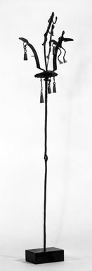 Dogon. <em>Staff Surmounted by Three Nommo Figures and 6 Bells</em>, late 19th-early 20th century. Wrought iron, 39 x 8 1/2 x 9 1/2 in. (99.0 x 21.6 x 24.1 cm). Brooklyn Museum, Gift of Lester Wunderman, 70.178.6. Creative Commons-BY (Photo: Brooklyn Museum, 70.178.6_bw.jpg)