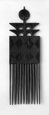 Akan. <em>Comb</em>, 20th century. Wood, 9 1/2 x 3 in. (24.1 x 7.6 cm). Brooklyn Museum, Gift of Ralph Nash to the Jennie Simpson Educational Collection of African Art, 70.30.2. Creative Commons-BY (Photo: Brooklyn Museum, 70.30.2_bw.jpg)