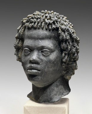 "Ancient Near Eastern. <em>Head of a Man with Tight, Curly Hair</em>, late 2nd century B.C.E. Marble, ""Bigio Morata"", 11 x 7 11/16 x 7 1/2 in. (28 x 19.5 x 19 cm). Brooklyn Museum, Charles Edwin Wilbour Fund, 70.59. Creative Commons-BY (Photo: Brooklyn Museum, 70.59_PS2.jpg)"