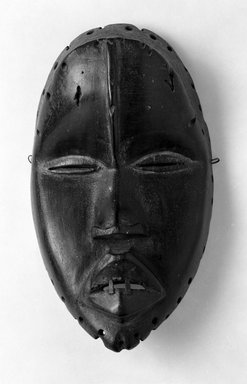 Dan. <em>Mask</em>, 19th or early 20th century. Wood, metal, pigment, 8 1/2 x 4 3/4 x 3 1/2 in. (21.6 x 12.1 x 8.9 cm). Brooklyn Museum, Gift of Merton D. Simpson to the Jennie Simpson Educational Collection of African Art, 70.73.3. Creative Commons-BY (Photo: Brooklyn Museum, 70.73.3_bw.jpg)