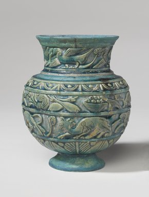 <em>Vessel with Relief Decoration</em>, ca. 1st century C.E. Faience, 7 1/4 x 5 1/2 x 5 1/2 in. (18.4 x 14 x 14 cm). Brooklyn Museum, Charles Edwin Wilbour Fund, 70.89.3. Creative Commons-BY (Photo: Brooklyn Museum, 70.89.3_side1_PS9.jpg)
