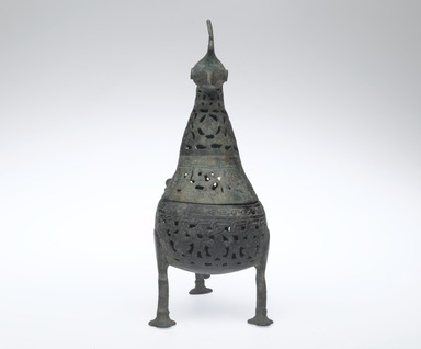 <em>Incense Burner in Shape of a Peacock</em>, 12th-13th century. Copper alloy, pierced and engraved, 10 1/2 x 11 1/2 in. (26.7 x 29.2 cm). Brooklyn Museum, Special Middle Eastern Art Fund, 70.98.1. Creative Commons-BY (Photo: Brooklyn Museum, 70.98.1_front_PS2.jpg)