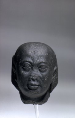 <em>Male Head with Recut Face</em>, 4th century B.C.E. and modern times. Basalt, 3 9/16 x 2 11/16 x 3 3/4 in. (9 x 6.9 x 9.5 cm). Brooklyn Museum, Charles Edwin Wilbour Fund, 71.10.2. Creative Commons-BY (Photo: Brooklyn Museum, 71.10.2_front.jpg)