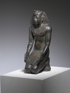<em>Kneeling Statuette of King Necho</em>, ca. 610-595 B.C.E. Bronze, 5 1/2 x 2 1/4 x 2 3/4in. (14 x 5.7 x 7cm). Brooklyn Museum, Charles Edwin Wilbour Fund, 71.11. Creative Commons-BY (Photo: Brooklyn Museum, 71.11_threequarter_PS1.jpg)