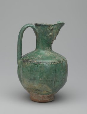 <em>Ewer</em>, 11th-12th century. Ceramic; earthenware, with an opaque green glaze, 7 1/4 x 5 in. (18.4 x 12.7 cm). Brooklyn Museum, Special Middle Eastern Art Fund, 71.15. Creative Commons-BY (Photo: Brooklyn Museum, 71.15_side1_PS2.jpg)