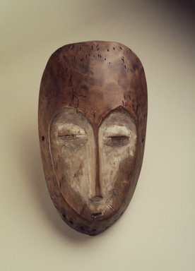 Lega. <em>Mask (Lukwakongo)</em>, 19th or 20th century. Wood, kaolin clay, 10 1/2 x 6 x 2 1/4 in. (26.7 x 15.2 x 5.7 cm). Brooklyn Museum, Gift of Nicholas A. de Kun, 71.173. Creative Commons-BY (Photo: Brooklyn Museum, 71.173.jpg)