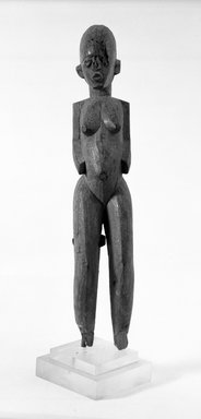 Lobi. <em>Standing Female Figure</em>, late 19th-early 20th century. Wood, 16 1/4 x 3 x 3 1/4 in. (41.3 x 7.6 x 8.3 cm). Brooklyn Museum, Gift of Dr. and Mrs. Abbott A. Lippman to the Jennie Simpson Educational Collection of African Art, 71.178.1. Creative Commons-BY (Photo: Brooklyn Museum, 71.178.1_bw.jpg)