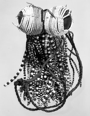 Turkana. <em>Fertility Doll</em>, late 19th-early 20th century. Beadwork over leather, wood, H: 5 1/4 in. (13.3 cm). Brooklyn Museum, Gift of Dr. Georges D. Rodrigues, 71.182. Creative Commons-BY (Photo: Brooklyn Museum, 71.182_view1_bw.jpg)