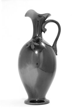 Rookwood Pottery Company (1880-1967). <em>Pitcher</em>, ca.1889. Glazed white earthenware, 21 1/2 x 6 1/8 in. (54.6 x 15.6 cm). Brooklyn Museum, Gift of Sybarites East Boutique, Inc., 71.187. Creative Commons-BY (Photo: Brooklyn Museum, 71.187_bw.jpg)