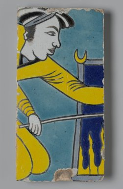 <em>Tile Fragment Depicting a Man Stoking a Fire</em>, first half of the 17th century. Ceramic; fritware, painted in yellow, turquoise, cobalt blue, black, opaque white, and light grayish blue glazes with manganese purple in the cuerda seca (dry-cord) technique, 9 1/4 x 4 3/4 in. (23.5 x 12.1 cm). Brooklyn Museum, Gift of Mr. and Mrs. Charles K. Wilkinson, 71.194.1. Creative Commons-BY (Photo: Brooklyn Museum, 71.194.1_PS2.jpg)