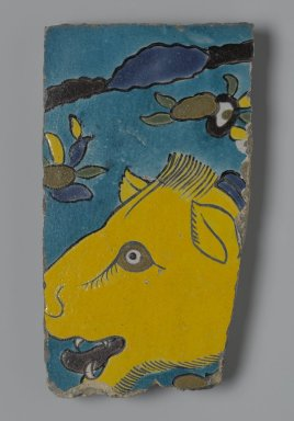 <em>Tile Fragment Depicting a Lion in a Landscape</em>, first half of the 17th century. Ceramic; fritware, painted in yellow, turquoise, cobalt blue, green, black, opaque white, purple, and ochre brown glazes with manganese purple in the cuerda seca (dry-cord) technique, 9 x 5 in. (22.9 x 12.7 cm). Brooklyn Museum, Gift of Mr. and Mrs. Charles K. Wilkinson, 71.194.2. Creative Commons-BY (Photo: Brooklyn Museum, 71.194.2_PS2.jpg)