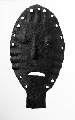Lega. <em>Mask</em>, late 19th or early 20th century. Iron, 7 3/4 x 4 1/4 x 1 in. (19.7 x 10.8 x 2.3 cm). Brooklyn Museum, Gift of David R. Markin, 71.21.2. Creative Commons-BY (Photo: Brooklyn Museum, 71.21.2_bw.jpg)