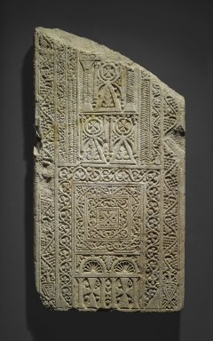 Coptic. <em>Stela with Glorified Ankhs and Crosses</em>, 7th-8th century C.E. Limestone, plaster, 35 7/16 x 18 7/8 x 2 9/16 in. (90 x 48 x 6.5 cm). Brooklyn Museum, Charles Edwin Wilbour Fund, 71.39.1. Creative Commons-BY (Photo: Brooklyn Museum, 71.39.1_PS1.jpg)
