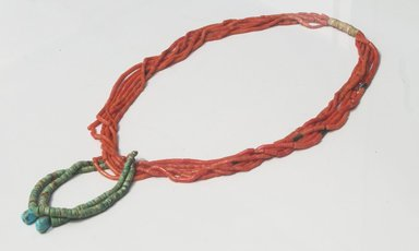 Navajo. <em>6-Strand Necklace</em>, ca. 1920s. Coral, silver, turquoise, cloth, 15 1/2 in.  (39.4 cm). Brooklyn Museum, Gift of Marjorie Ruth Wagner, 71.57.1. Creative Commons-BY (Photo: Brooklyn Museum, 71.57.1_side_installation_PS5.jpg)