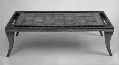 American. <em>Coffee Table</em>, ca. 1939. Wood, glazed earthenware, leather, 11 3/8 x 41 1/2 x 25 3/8 in. (28.9 x 105.4 x 64.5 cm). Brooklyn Museum, Gift of Hollis K. Thayer, 71.96. Creative Commons-BY (Photo: Brooklyn Museum, 71.96_cropped_bw_IMLS.jpg)