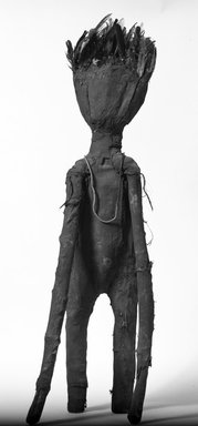 Senufo. <em>Oracle Figure (Kafigeledjo)</em>, late 19th or early 20th century. Cloth, wood, glass beads, feathers, 37 3/4 x 7 3/4 x 4 1/4 in. (95.5 x 19.7 x 10.8 cm). Brooklyn Museum, Gift of Fernandez Arman to the Jennie Simpson Educational Collection of African Art, 72.102.3. Creative Commons-BY (Photo: Brooklyn Museum, 72.102.3_bw.jpg)