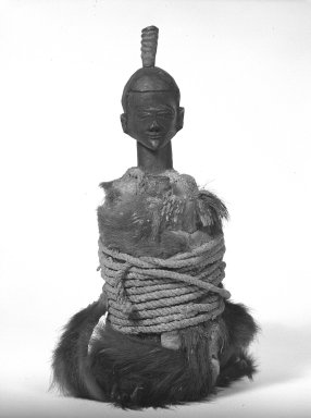 Tetela. <em>Power Figure (Nkishi)</em>, early 20th century. Wood, fur, hide, fiber, horn, 17 in.  (43.2 cm). Brooklyn Museum, Gift of Fernandez Arman to the Jennie Simpson Educational Collection of African Art, 72.102.4. Creative Commons-BY (Photo: Brooklyn Museum, 72.102.4_bw.jpg)