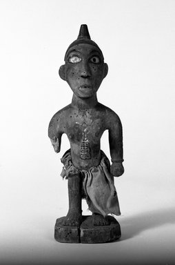 Kongo. <em>Standing Female Figure</em>, late 19th-early 20th century. Wood, pigment, fiber, glass mirror, 10 3/4 x 3 1/2 x 3 1/8 in. (27.0 x 9.0 x 8.0 cm). Brooklyn Museum, Gift of Fernandez Arman to the Jennie Simpson Educational Collection of African Art, 72.102.5. Creative Commons-BY (Photo: Brooklyn Museum, 72.102.5_bw.jpg)