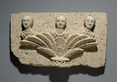 <em>Three Busts on a Capital</em>, 20th century (probably). Nummulitic limestone, 9 1/4 x 16 9/16 x 3 7/8 in. (23.5 x 42 x 9.8 cm). Brooklyn Museum, Charles Edwin Wilbour Fund, 72.10. Creative Commons-BY (Photo: Brooklyn Museum, 72.10_PS1.jpg)