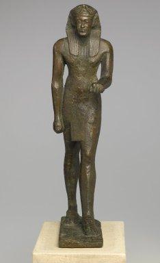 <em>Standing Royal Figure</em>, 30 B.C.E.-642 C.E. Bronze, 14 x 3 3/4 x 5 1/2 in. (35.6 x 9.5 x 14 cm). Brooklyn Museum, Gift of Helena Simkhovitch in memory of her father, Vladimir G. Simkhovitch, 72.129. Creative Commons-BY (Photo: Brooklyn Museum, 72.129_front_PS1.jpg)