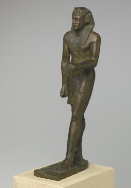<em>Standing Royal Figure</em>, 30 B.C.E.-642 C.E. Bronze, 14 x 3 3/4 x 5 1/2 in. (35.6 x 9.5 x 14 cm). Brooklyn Museum, Gift of Helena Simkhovitch in memory of her father, Vladimir G. Simkhovitch, 72.129. Creative Commons-BY (Photo: , 72.129_threequarter_left_PS1.jpg)
