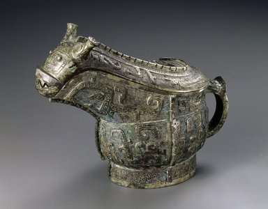 <em>Ritual Wine Vessel (Guang)</em>, 13th-11th century B.C.E. Bronze, 6 1/2 x 3 1/4 x 8 1/2 in. (16.5 x 8.3 x 21.6 cm). Brooklyn Museum, Gift of Mr. and Mrs. Alastair B. Martin, the Guennol Collection, 72.163a-b. Creative Commons-BY (Photo: Brooklyn Museum, 72.163a-b_SL1.jpg)