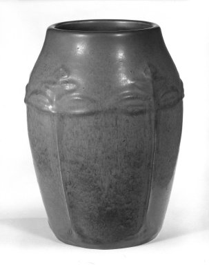 J.S. Taft & Company. <em>Vase</em>, ca. 1904-1914. Earthenware, mat glaze, 7 1/4 x 3 1/2 in. (18.4 x 8.9 cm). Brooklyn Museum, Gift of Mrs. Ben P. Grant in memory of Dr. and Mrs. Henry Fleming Payne, 72.184.3. Creative Commons-BY (Photo: Brooklyn Museum, 72.184.3_bw.jpg)