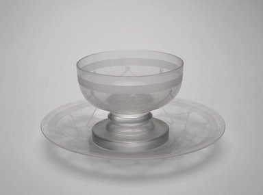"Steuben Glass, a division of Corning Glass Works, 1903-2011. <em>Sherbet Glass and Plate, ""St. Tropez,""  Part of Nine-Piece Setting</em>, ca.1933. Glass, (a) Glass: 3 x 3 15/16 x 3 15/16 in. (7.6 x 10 x 10 cm). Brooklyn Museum, H. Randolph Lever Fund, 72.40.18a-b. Creative Commons-BY (Photo: Brooklyn Museum, 72.40.18a-b_Justin_van_Soest_photograph.jpg)"