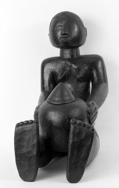 Luba. <em>Seated Female Figure Holding Lidded Receptacle (Mboko)</em>, late 19th or early 20th century. Wood, 20 1/2 x 9 1/2 x 18 in. (52.0 x 24.2 x 46.0 cm). Brooklyn Museum, Gift of Dr. and Mrs. Jay T. Last, 72.48a-b. Creative Commons-BY (Photo: Brooklyn Museum, 72.48a-b_front_bw.jpg)