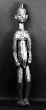 Igbo (northern). <em>Standing Hermaphroditic Shrine Figure</em>, late 19th or early 20th century. Wood, pigment, 65 1/4 x 12 x 10 in. (165.6 x 30.5 x 25.5cm). Brooklyn Museum, Gift of Vivian Merrin, 73.10.2. Creative Commons-BY (Photo: Brooklyn Museum, 73.10.2_bw.jpg)