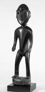 Senufo. <em>Standing Figure</em>, 20th century. Wood, 13 5/8 x 3 1/2 x 3 1/4 in. (34.5 x 8.9 x 8.3 cm). Brooklyn Museum, Gift of Mr. and Mrs. John A. Friede, 73.107.12. Creative Commons-BY (Photo: Brooklyn Museum, 73.107.12_bw.jpg)