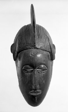 Senufo. <em>Mask of a Human Face</em>, late 19th or early 20th century. Wood, h: 12 3/4 in. (32.5 cm). Brooklyn Museum, Gift of Mr. and Mrs. John A. Friede, 73.107.9. Creative Commons-BY (Photo: Brooklyn Museum, 73.107.9_bw.jpg)