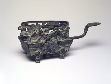 <em>Brazier</em>, 206 B.C.E.-220 C.E. Bronze, 9 3/8 x 3 1/2 x 7 in. (23.8 x 8.9 x 17.8 cm). Brooklyn Museum, Gift of John J. Waterman in memory of Edwin Mathews Blumenthal, 73.125.1. Creative Commons-BY (Photo: Brooklyn Museum, 73.125.1.jpg)