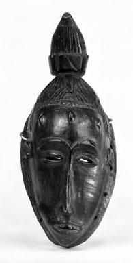 Guro. <em>Mask with Conical Topknot</em>, late 19th-early 20th century. Wood, pigment, 11 1/2 x 5 in. (29.3 x 12.7 cm). Brooklyn Museum, Gift of Dr. and Mrs. Abbott A. Lippman, 73.154.10. Creative Commons-BY (Photo: Brooklyn Museum, 73.154.10_bw.jpg)