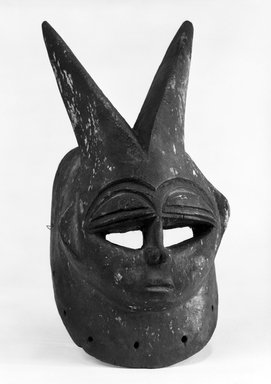 Edo. <em>Face Mask with Two Horns</em>, late 19th or early 20th century. Wood, pigment, metal, 12 1/2 x 6 1/4 x 5 1/4 in. Brooklyn Museum, Gift of Dr. and Mrs. Abbott A. Lippman, 73.154.11. Creative Commons-BY (Photo: Brooklyn Museum, 73.154.11_bw.jpg)