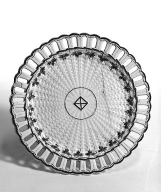 John Turner (1756-1786). <em>Plate</em>, ca. 1762-1780. Creamware with lead glaze and enamel, 7/16 x 7 5/8 in. (1.1 x 19.4 cm). Brooklyn Museum, Gift of Mrs. George Backer, 73.16.5. Creative Commons-BY (Photo: Brooklyn Museum, 73.16.5_bw.jpg)