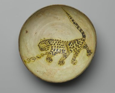 <em>Bowl Depicting a Cheetah</em>, 10th century. Ceramic; earthenware, painted in yellow-staining black slip on a white slip ground under a transparent glaze, 3 3/8 x 8 7/8 in. (8.5 x 22.5 cm). Brooklyn Museum, Frederick Loeser Fund, 73.165. Creative Commons-BY (Photo: Brooklyn Museum, 73.165_top_PS2.jpg)