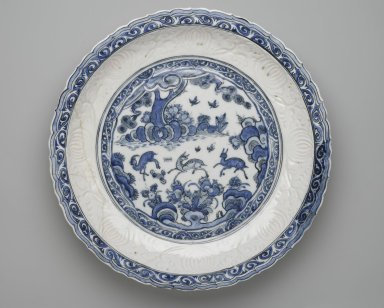 <em>Platter (Tabaq) with Chinese Landscape</em>, first half 17th century. Ceramic; fritware, molded and painted in cobalt blue under a transparent glaze, Gr. diam.: 19 in. (48.3 cm). Brooklyn Museum, Carll H. de Silver Fund, 73.166. Creative Commons-BY (Photo: Brooklyn Museum, 73.166_top_PS2.jpg)
