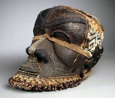 Kuba (Bushoong subgroup). <em>Bwoom Mask</em>, late 19th or early 20th century. Wood, copper alloy, skin, fur, plant fiber, textile, glass beads, cowrie shell, seedpods, pigments, 13 3/4 x 8 1/4 x 12 in. (35 x 21 x 30.5 cm). Brooklyn Museum, Gift of Mr. and Mrs. John McDonald, 73.178. Creative Commons-BY (Photo: Brooklyn Museum, 73.178_SL1.jpg)