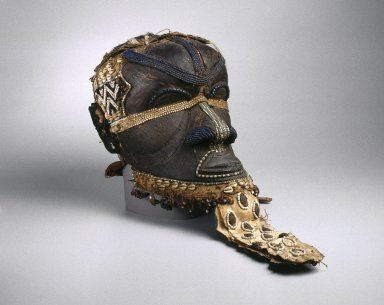 Kuba (Bushoong subgroup). <em>Bwoom Mask</em>, late 19th or early 20th century. Wood, copper alloy, skin, fur, plant fiber, textile, glass beads, cowrie shell, seedpods, pigments, 13 3/4 x 8 1/4 x 12 in. (35 x 21 x 30.5 cm). Brooklyn Museum, Gift of Mr. and Mrs. John McDonald, 73.178. Creative Commons-BY (Photo: Brooklyn Museum, 73.178_threequarter_edited_version_SL1.jpg)