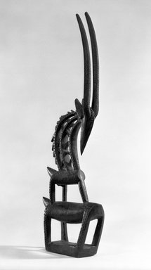 Bamana. <em>Dance Headdress (Ci-wara)</em>, late 19th-early 20th century. Wood, horns, 19 x 9 1/2 x 3in. (48.3 x 24.1 x 7.6cm). Brooklyn Museum, Gift of Gaston T. de Havenon, 73.179.2. Creative Commons-BY (Photo: Brooklyn Museum, 73.179.2_bw.jpg)